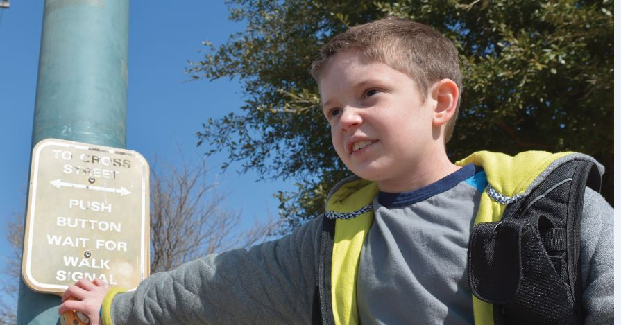 photo of kid waking at a signal